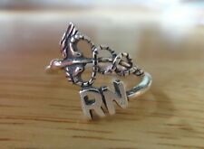 size 6.5 Sterling Silver says RN Registered Nurse with Caduceus Ring