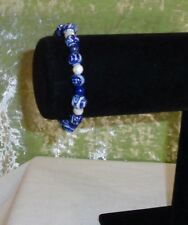 BRACELET WITH BLUE BEADS AND WHITE BEADS