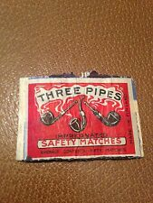 old match box top - three pipes .made in england