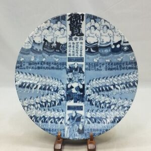 A854: Rare, Japanese plate of porcelain with fine pattern of many sumo wrestlers