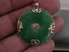 Lovely 1.5' green jade donut pendant 14kt gold