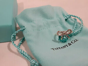 Tiffany & Co. Bow Ring- SS AG925- Size 5.5- Box and Pouch included