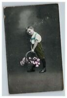Vintage 1900's Colorized Photo Postcard Boy Holds a Basket of Pink Flowers