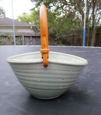 CELADON PORCELAIN BASKET with BAMBOO HANDLE by MARY LAW. BYRON TEMPLE INTEREST