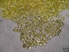 STRASS EN VERRE DE COULEUR JAUNE TRANSPARENT.150 GR.