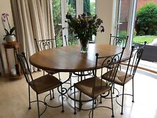 Elegant Wrought iron garden table and chairs.