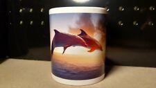 Beautiful dolphins jumping at sunrise / sunset - 11 ounce ceramic coffee mug