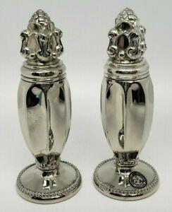 antique set of salt and pepper set