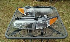 PONTIAC GRAND PRIX HEAD LIGHTS OEM 1997-2002