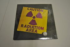 LP 33 AREA CAUTION RADIATION AREA PROG AKARMA AK 395  SIGILLATO