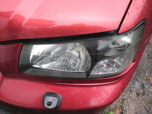 2004 SUBARU FORESTER NEAR SIDE HEADLIGHT BREAKING SUBARU FORESTER