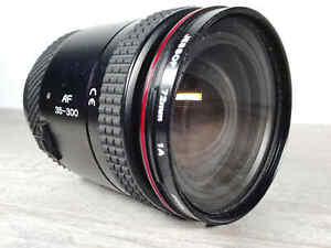Tokina AF 35-300mm f/4.5-6.7 Lens for Pentax Telephot Autofocus w/ 1A Filter SLR