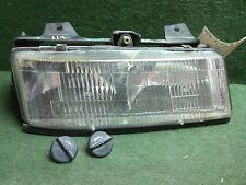 1990 - 1996 Chevrolet Corsica RH passenger headlight & mount bracket 16505534