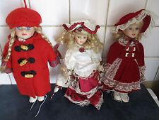 Lot de 3 belles poupées en porcelaine d'environ 25 centimètres de hauteur en TBE