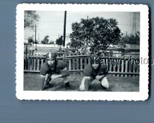 Black & White Photo J_6971 Teen Boys Posed In Football Uniforms Crouching