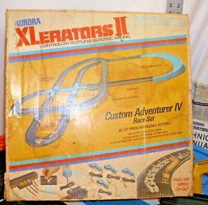 AURORA XLERATORS II CUSTOM ADVENTURER IV RACE SET WITH FOUR CARS 1970s BOXED
