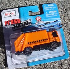 2017 Maisto Fresh Metal.  International Orange Garbage Truck.  New in Package
