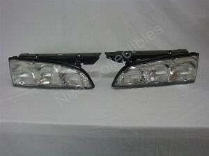 NOS OEM Pontiac Bonneville Head Lamp Lights 1992 - 93 PAIR