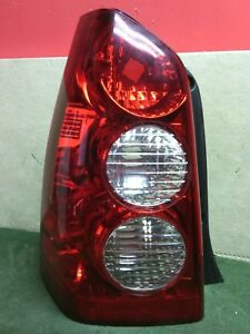 2005 - 2006 Mazda Tribute LH DRIVER side tail light Used OEM 5T24-13B505