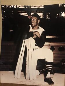 Photo Of ROBERTO CLEMENTE (16 X 20) Resting On Bats Waiting For His At Bat.