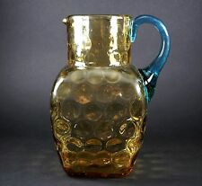 Antique Thumb Print Glass Topaz and Applied Blue Handle Glass Pitcher