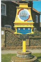 VINTAGE POSTCARD: THE TOWN SIGN ~  WELLS-NEXT-THE-SEA ~ NORFOLK   / SALMON LTD