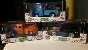 M2 MACHINES WILD CARDS (2) 1956 FORD COE TOW TRUCK, FORD F100,    3 cars total