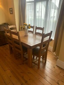 extending solid oak dining table and 6 ladderback chairs
