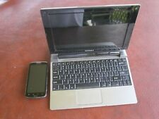 Motorola lapdock and smartphone.W/charger..both in perfect working order Atrix 2
