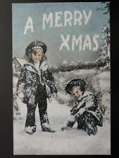 A MERRY XMAS - TWO CHILDREN PLAYING IN THE SNOW c1905 Postcard by Valentine