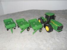 """John Deere (ERTL) Articulated (4"""") Tractor w/ 3 (2"""") pull wagons (toy)"""