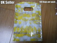 100 x CLEAR PLASTIC YELLOW SWIRLS GIFT PARTY CARRIER BAGS SHOPS SWEETS 18cmx12cm
