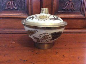 Metal and enamel rustic lidded pot