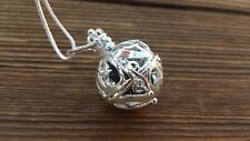 ROUND FILIGREE CAGE PENDANT WITH BLACK TOURMALINE CRYSTAL PENDANT