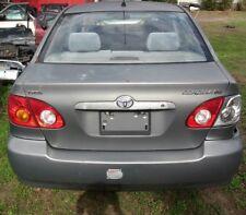 Toyota trunk latch lock assy 2003 Corolla genuine OEM 64610-02071