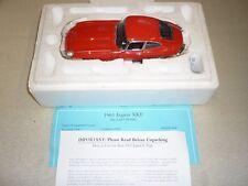 A Franklin mint scale model of a 1961 Jaguar XKE / E Type, boxed