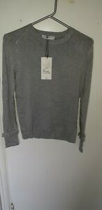 Zara ladies jumper large. Grey colour with pearl and frill detail on cuffs. New!