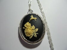 CAMEO LOCKET ROSES WITH A HUMMINGBIRD  BLACK AND IVORY