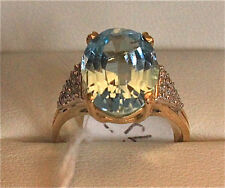 14ct Gold ring with topaz + diamonds. Valued at $1800!!