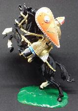 ELASTOLIN chevalier français armure dorée écu orange sur son destrier noir cabré