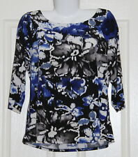 Womens size XL (16) stretchy top made by ROCKMANS