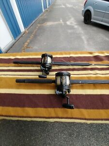 2 SHIMANO TRITON BEASTMASTER 30/50 REELS WITH RODS