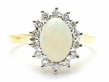 White Opal Ring 1.25ct. with Diamonds 0.14ct. Yellow 18ct. Gold Ring. Size N