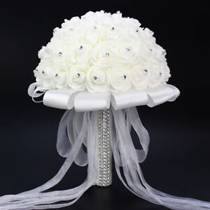 Romantic Wedding Bride Holding Bouquet Roses Crystal Diamond Ribbon Flower White