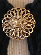 The mattie gold tone flower sweater clip brooch