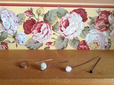 Four antique hat pins