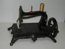 ANTIQUE CAST IRON  WERTHEIM  HAND CRANK SEWING MACHINE, BUILT TO LAST