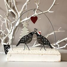 Lovey dovey quails standing Christmas decoration. Shoeless joe. Love birds. Snow