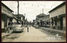 3073 - MEXICO Nogales 1940s Calle Elias. Stores. Old Cars. Real Photo Postcard