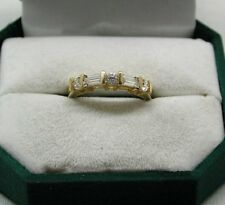A Very Nice 9ct Gold Baguette And Round White Stone Ring